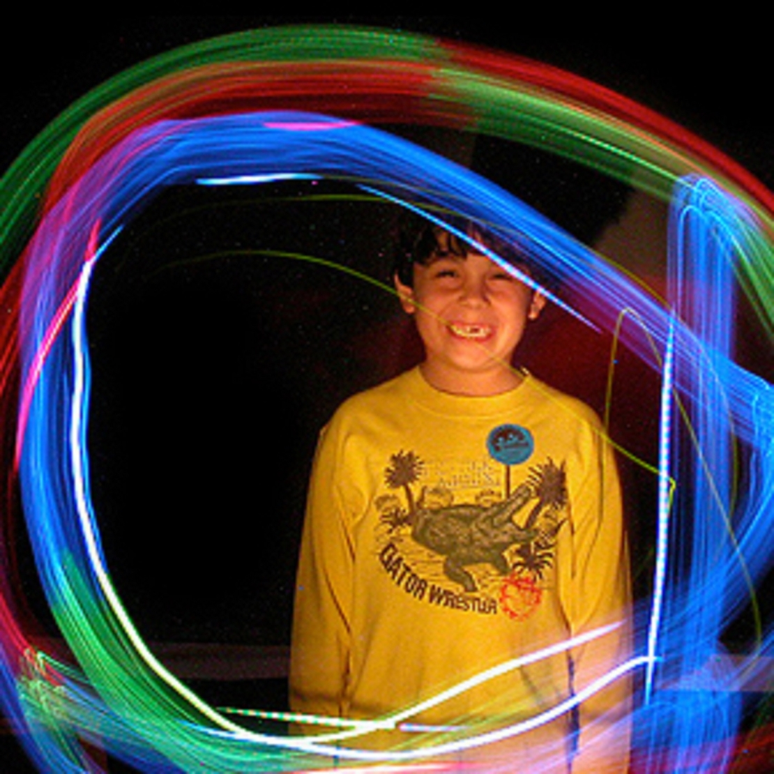Boy circled by neon lights